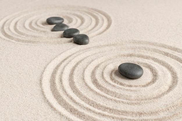 Concept de santé et de bien-être de fond de sable de pierres zen