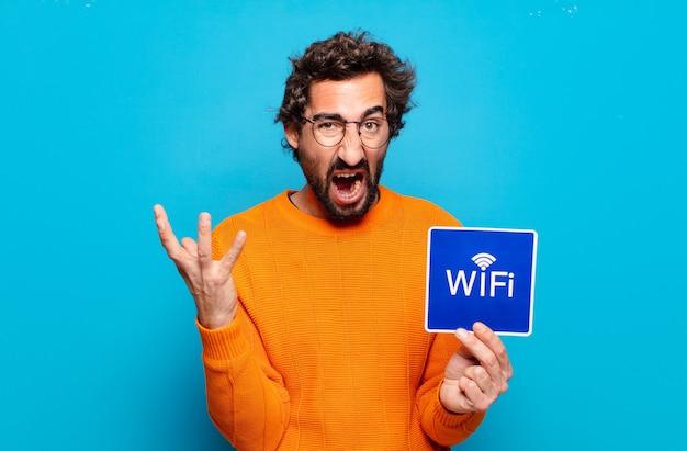 Concept de wifi gratuit jeune homme barbu
