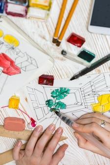 Le concepteur fait un croquis de l'arrière-plan intérieur des marqueurs de dessin de la gomme à crayon de la calculatrice de la règle