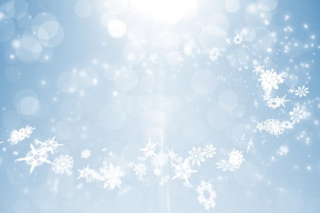 Conception bleue avec des flocons de neige blanches