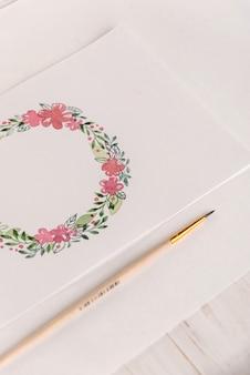 Conception de cadre de fleurs peint à l'aquarelle sur papier