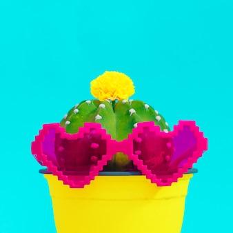 Conception colorée de cactus. concept d'amant de vacances avec des coeurs de lunettes de soleil élégants