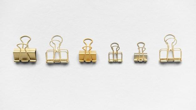 Conception de fond de trombone de papeterie d'or