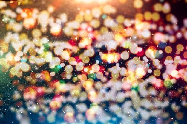 La conception de la mise en page de fond de paillettes de lumière floue abstraite colorée peut être utilisée pour le concept d'arrière-plan ou l'arrière-plan du festival