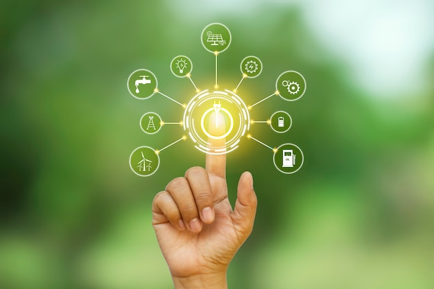 Conception numérique d'un bouton d'alimentation appuyé par une main et entouré de plus d'icônes.