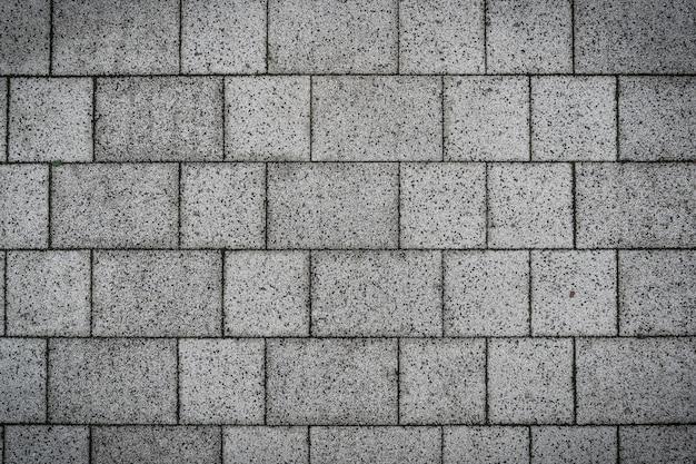 Conception de texture de sol pavé de pierres de roches de brique grise