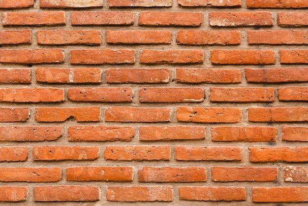 Conception de texture urbaine de briques sur un mur