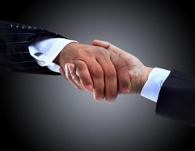 La conclusion de la poignée de main de la transaction