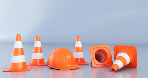 Cônes de signalisation et casque orange isolé sur fond gris
