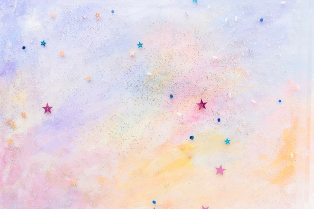 Confettis étoiles scintillantes sur fond aquarelle pastel abstrait coloré