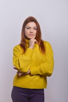Confiant, jeune femme, à, doigt menton