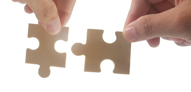 Connexion du puzzle à la main concept de réussite et de stratégie des solutions d'affaires