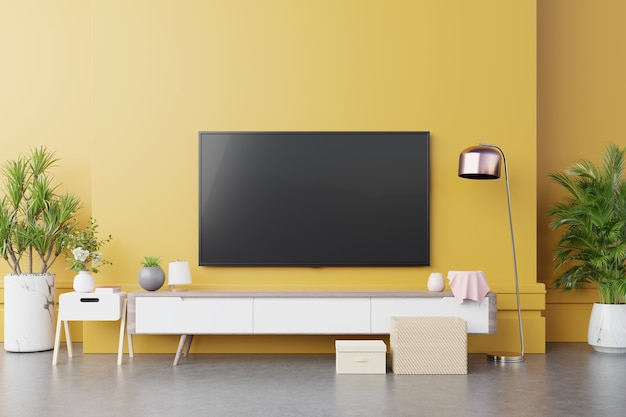 Console murale tv dans un salon moderne avec lampe, table, fleur et plante sur fond de mur lumineux jaune, rendu 3d