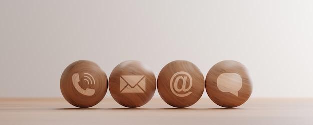 Contactez-nous les icônes impriment l'écran sur une sphère en bois telle que l'adresse e-mail d'appel et le message pour le service client et l'auto-assistance pour le travail à domicile wfh en raison du virus corona ou de la pandémie covid19 par rendu 3d.
