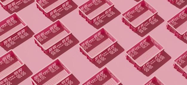 Conteneur de caisse en plastique rose sur fond rose