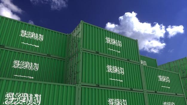Les conteneurs du pavillon de l'arabie saoudite sont situés au terminal à conteneurs. concept d'exportation ou d'importation de l'arabie saoudite, rendu 3d.