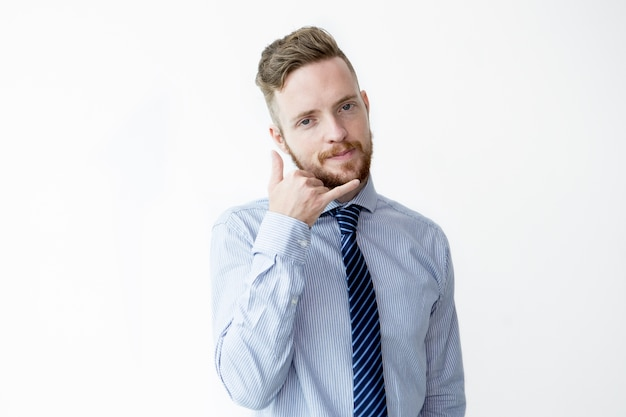 Contenu business man making call me gesture