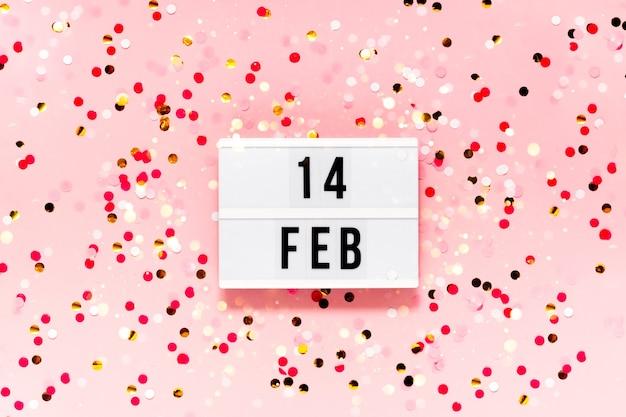 Contexte festif de la saint-valentin. lumières bokeh et confettis 14 février