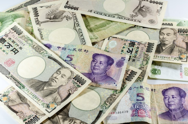 Contexte de la monnaie asiatique (monnaie chinoise yuan chinois et yen japonais)