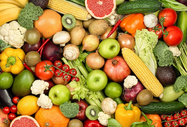 Contexte de nombreux fruits et légumes frais
