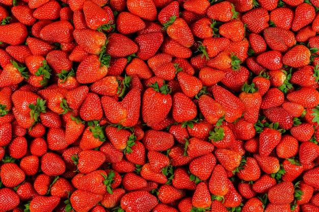 Contexte de nombreux morceaux de fraises
