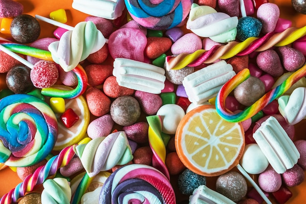 Contexte de la variété de bonbons, sucettes, gomme, bonbons