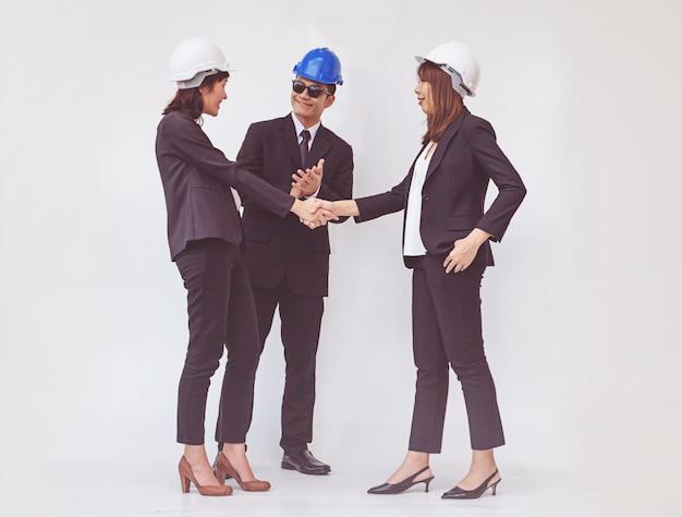 Contremaître affaires, serrer la main, finir une réunion
