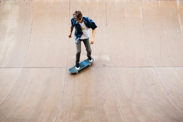 Cool man enjoyng skating