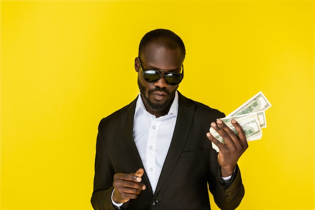 Cool man holding dollars