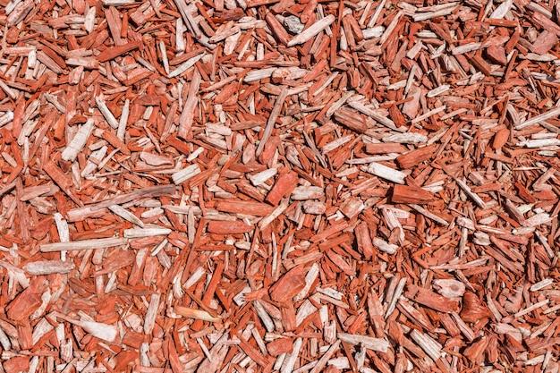 Copeaux de bois en vrac, sciure décorative rouge, fond de copeaux
