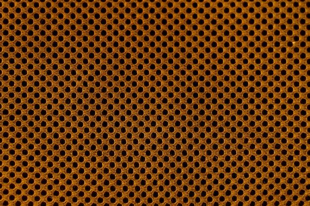 Copiez l'espace matériel doré avec des points noirs