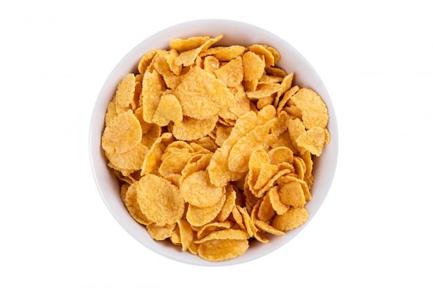 Corn flakes dans un bol isolé