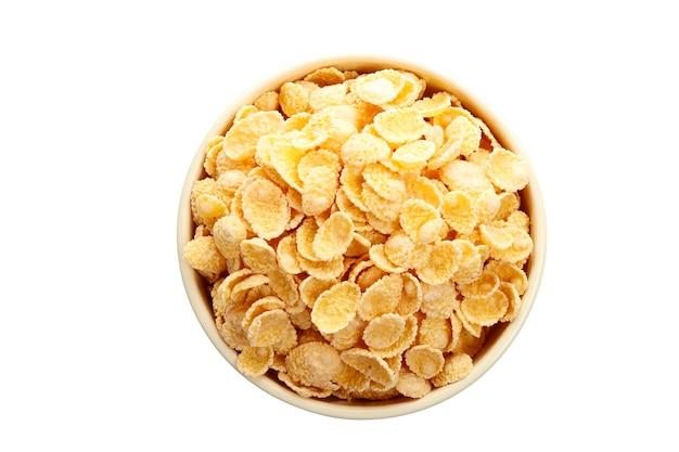 Cornflakes dans un bol isolé sur fond blanc