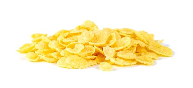 Cornflakes savoureux isolés sur un blanc, céréales sèches, petit déjeuner