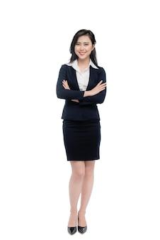 Corps entier d'une jeune femme d'affaires séduisante isolée sur blanc.