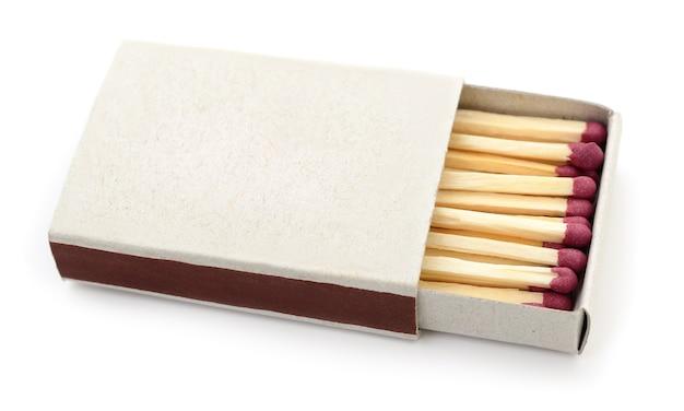 Correspondances dans une boîte d'allumettes sur blanc.