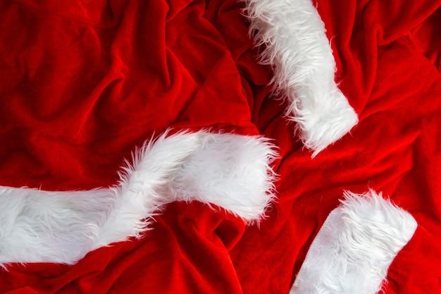 Costume de père noël, texture de fond de tissu de costume, gros plan de concept de noël