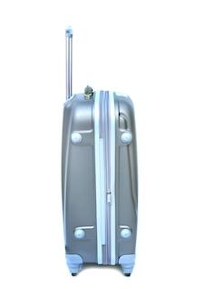À côté des bagages de voyage isolés sur le blanc