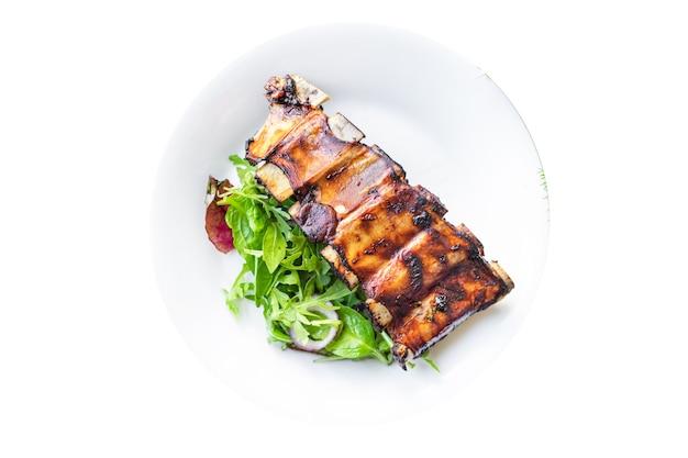 Côtes levées viande cuite au four bbq porc bœuf frit ou agneau sauce épices piquantes