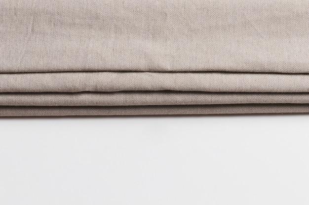 Couches pliables de matériaux en tissu