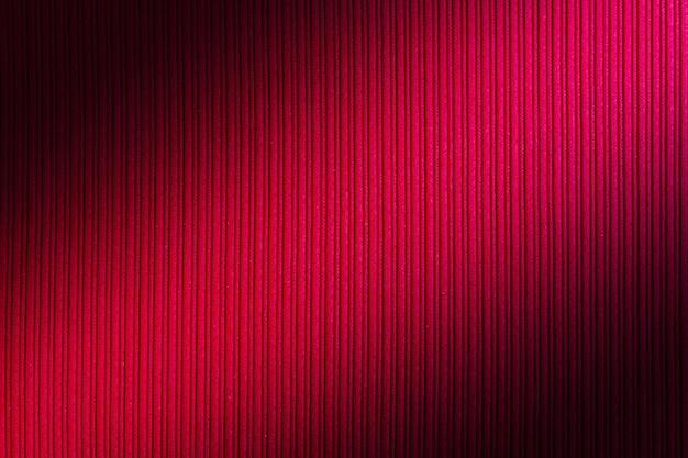 Couleur de fond décoratif rouge, dégradé diagonal de texture rayée.