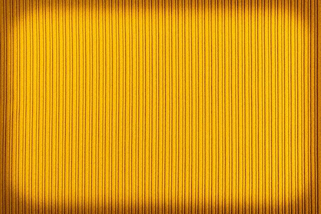 Couleur jaune décorative, dégradé de vignettage de texture rayée.