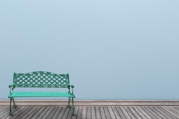Couleur pastel de mur 3d et chaise verte