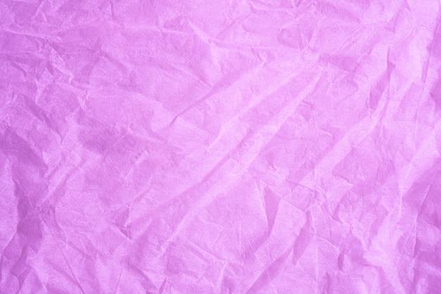 Couleur rose texture de fond de papier tissu froissé