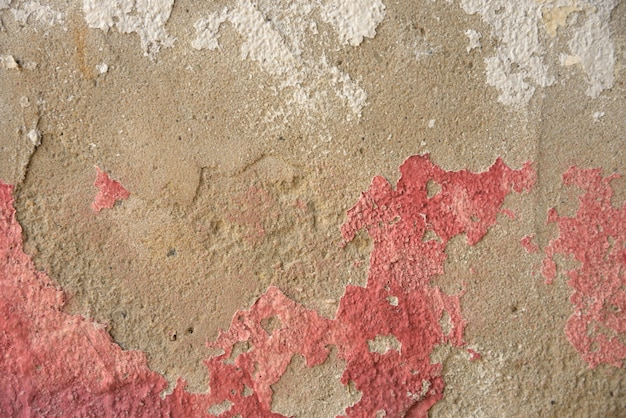 Couleur rouge sur la texture et le fond de ciment