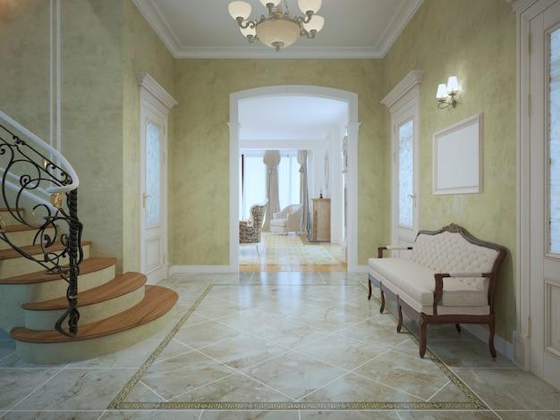 Couloir cher et lumineux avec escaliers et banc de luxe couleur crème avec encadrement en bois d'acajou.