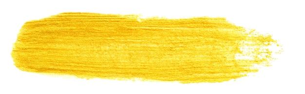 Coup de frottis de couleur or jaune isolé sur fond blanc, pinceau acrylique doré dessiné à la main, texture festive abstraite, illustration de photo stock