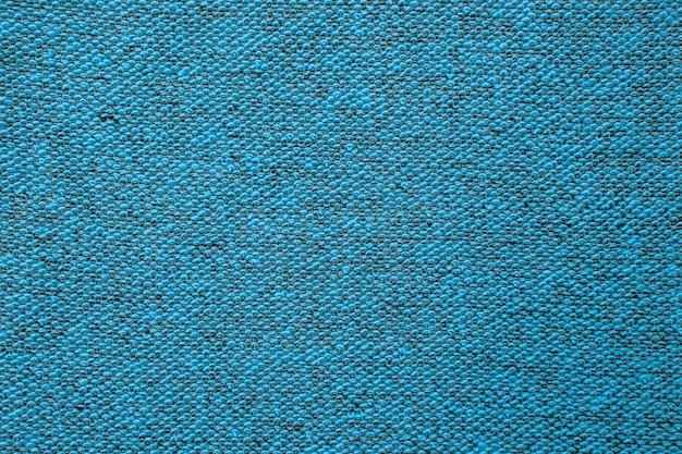 Coup de macro d'un fond de texture éponge. revêtement de sol textile. moquette à poils noués