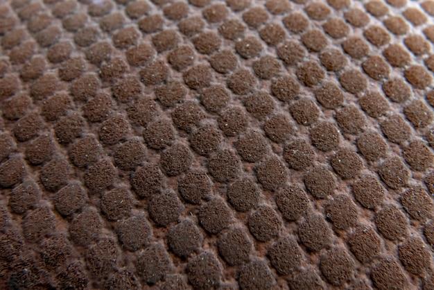 Coup de macro d'une texture de ballon de basket rayé utilisé