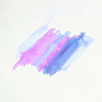 Coup de pinceau abstrait bleu et rose sur du papier blanc